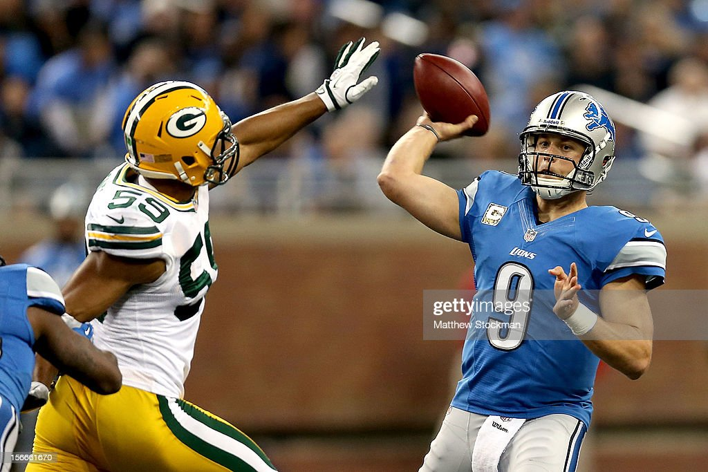 Quarterback <a gi-track='captionPersonalityLinkClicked' href=/galleries/search?phrase=Matthew+Stafford&family=editorial&specificpeople=3228634 ng-click='$event.stopPropagation()'>Matthew Stafford</a> #12 of the Detroit throws under pressur by Brad Jones #59 of the Green Bay Packers at Ford Field on November 18, 2012 in Detroit, Michigan.