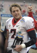 Quarterback Matthew Stafford of the University of Georgia holds the most valuable player trophy after play against the Michigan State Spartans during...