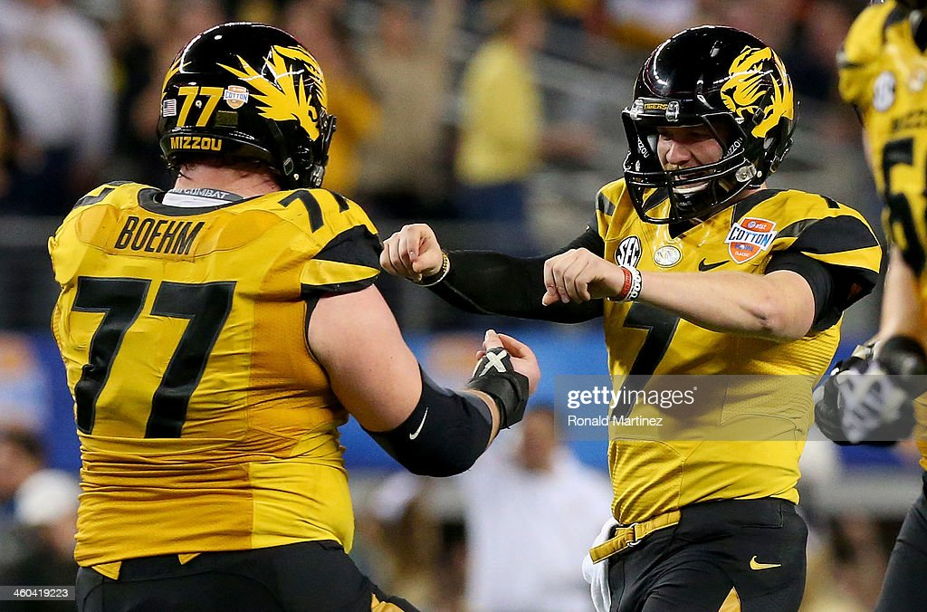 Quarterback Maty Mauk #7 of the Missouri Tigers celebrates with Evan Boehm #77 after Mauk throws a 24-yard touchdown pass in the second quarter against the Oklahoma State Cowboys during the AT&T Cotton Bowl on January 3, 2014 in Arlington, Texas.