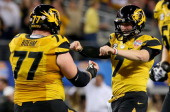 Quarterback Maty Mauk of the Missouri Tigers celebrates with Evan Boehm after Mauk throws a 24yard touchdown pass in the second quarter against the...