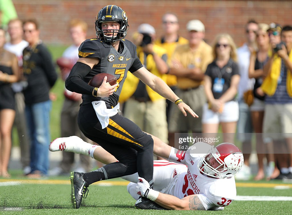 Quarterback Maty Mauk #7 of the Missouri Tigers is sacked by Zack Shaw #33 of the Indiana Hoosiers in the first quarter at Memorial Stadium on September 20, 2014 in Columbia, Missouri.