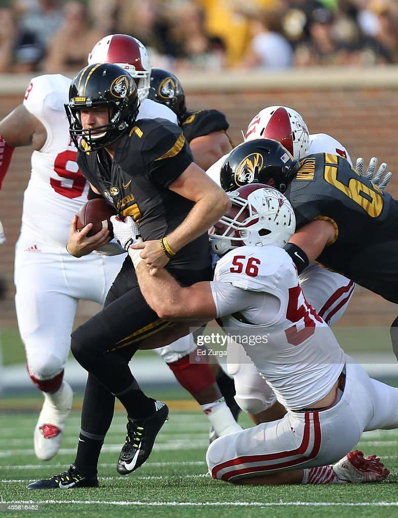 Quarterback Maty Mauk #7 of the Missouri Tigers is tackled by defensive end Nick Mangieri #56 of the Indiana Hoosiers at Memorial Stadium on September 20, 2014 in Columbia, Missouri. Indiana won 31-27.