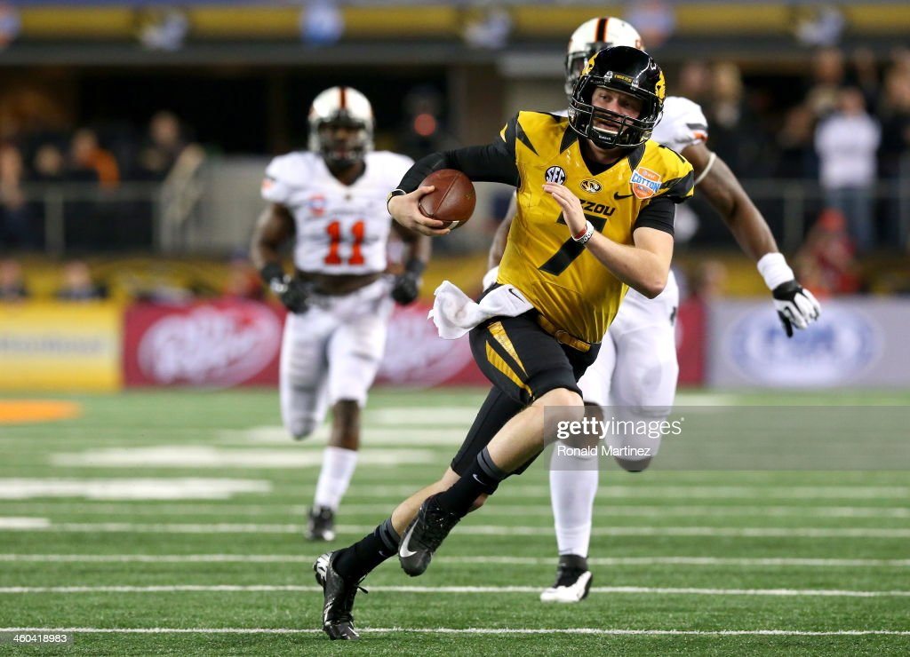 Quarterback Maty Mauk #7 of the Missouri Tigers runs the ball against the Oklahoma State Cowboys in the second quarter during the AT&T Cotton Bowl on January 3, 2014 in Arlington, Texas.