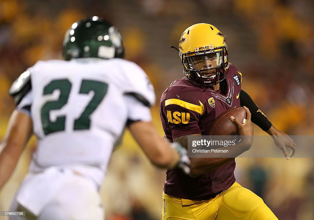 Quarterback Michael Eubank #9 of the Arizona State Sun Devils scrambles with the football against linebacker Russell Smith #27 of the Sacramento State Hornets during the first quarter of the college football game at Sun Devil Stadium on September 5, 2013 in Tempe, Arizona.