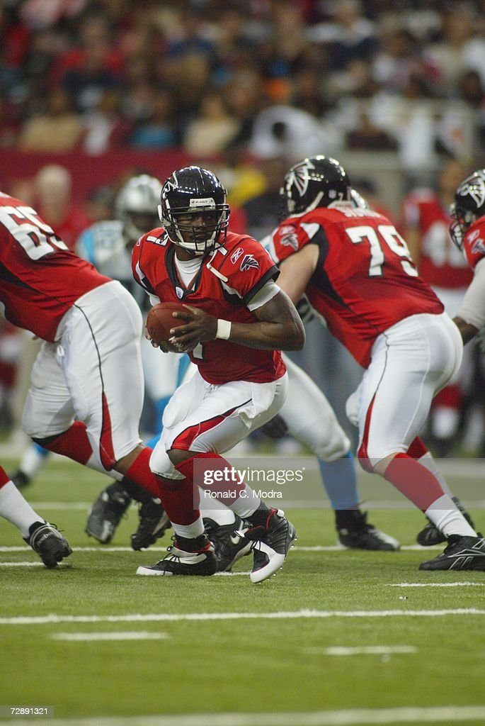 Quarterback Michael Vick #7 of the Atlanta Falcons rolls out with the ball during the NFL game on January 1, 2006 against the Carolina Panthers at the Georgia Dome in Atlanta, Georgia.