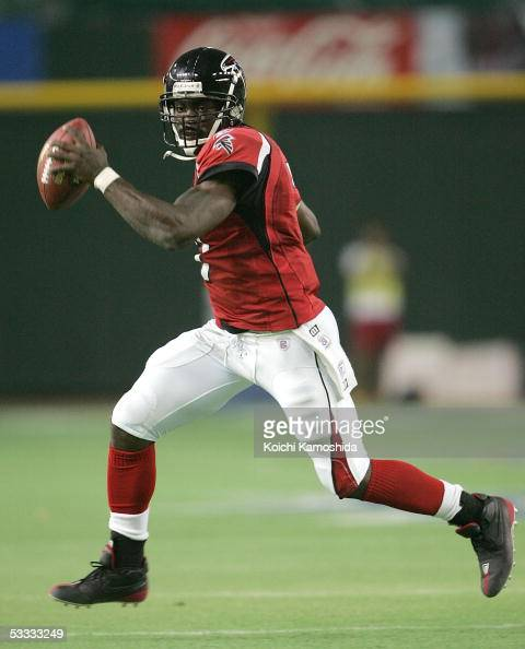 Quarterback Michael Vick of the Atlanta Falcons runs against the Indianapolis Colts during the NFL's preseason opener 'NFL Tokyo 2005' on August 6...