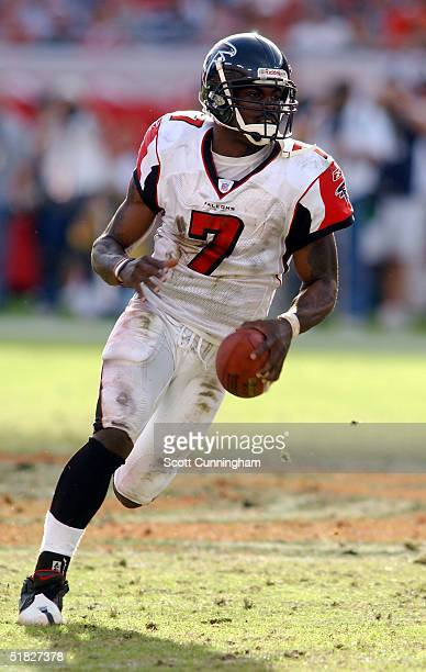 Quarterback Michael Vick of the Atlanta Falcons scrambles against the Tampa Bay Buccaneers in a game on December 5 2004 at Raymond James Stadium in...