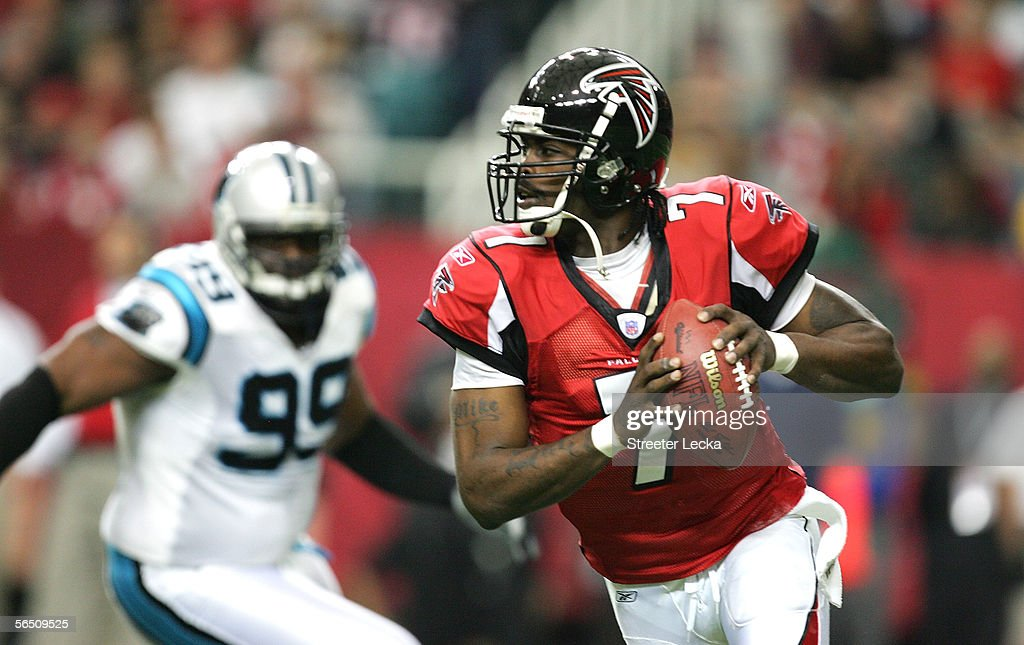 Quarterback Michael Vick #7 of the Atlanta Falcons scrambles against the defense of the Carolina Panthers during the 1st quarter of the game at the Georgia Dome on January 1, 2006 in Atlanta, Georgia.