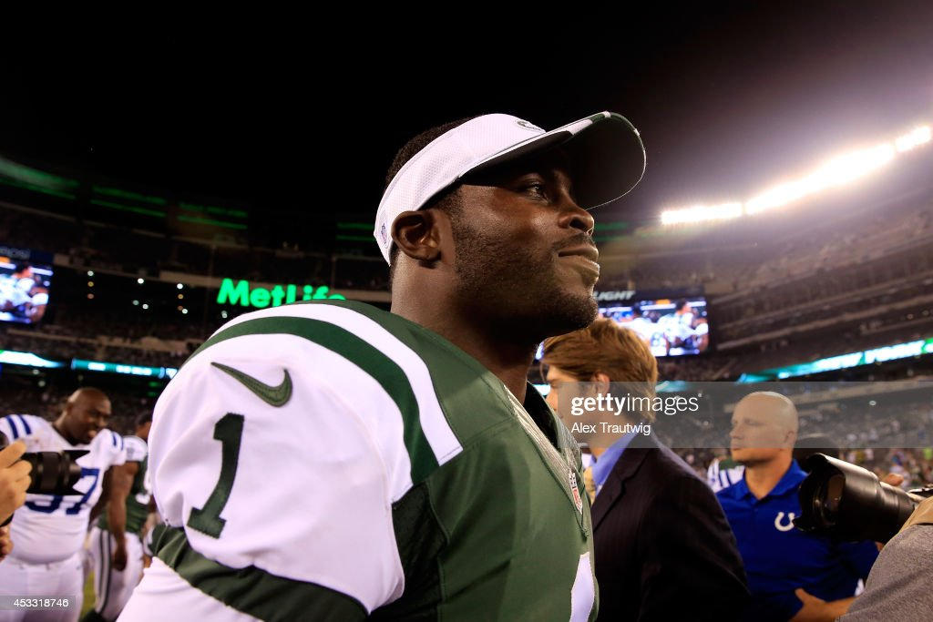 Quarterback Michael Vick #1 of the New York Jets walks on the field after defeating the Indianapolis Colts 13-10 in a preseason game at MetLife Stadium on August 7, 2014 in East Rutherford, New Jersey.