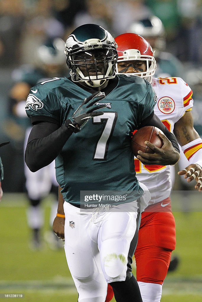 Quarterback <a gi-track='captionPersonalityLinkClicked' href=/galleries/search?phrase=Michael+Vick&family=editorial&specificpeople=201746 ng-click='$event.stopPropagation()'>Michael Vick</a> #7 of the Philadelphia Eagles carries the ball during a game against the Kansas City Chiefs on September 19, 2013 at Lincoln Financial Field in Philadelphia, Pennsylvania. The Chiefs won 26-16.