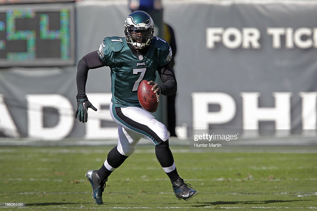 Quarterback <a gi-track='captionPersonalityLinkClicked' href=/galleries/search?phrase=Michael+Vick&family=editorial&specificpeople=201746 ng-click='$event.stopPropagation()'>Michael Vick</a> #7 of the Philadelphia Eagles runs out of the pocket during a game against the New York Giants on October 27, 2013 at Lincoln Financial Field in Philadelphia, Pennsylvania. The Giants won 15-7.