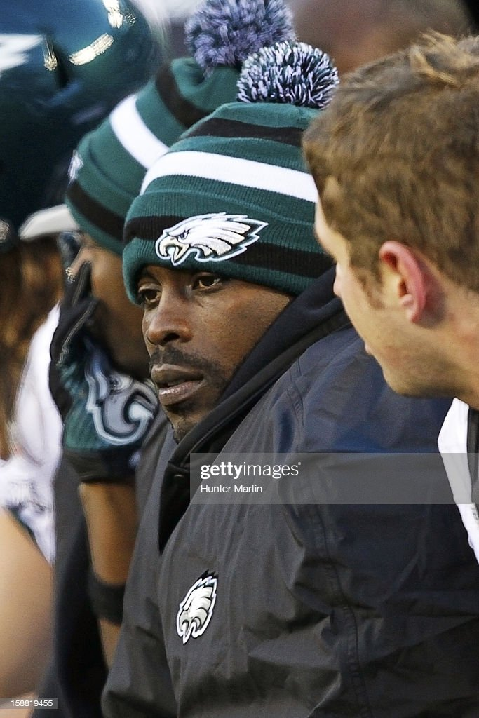 Quarterback Michael Vick #7 of the Philadelphia Eagles sits on the bench at the end of a game against the New York Giants on December 30, 2012 at MetLife Stadium in East Rutherford, New Jersey. The Giants won 42-7.