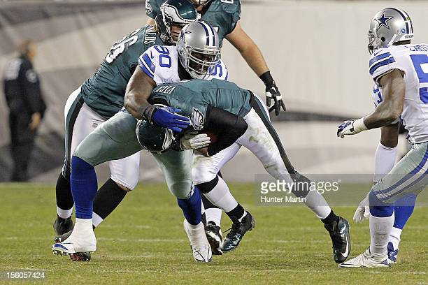 Quarterback Michael Vick of the Philadelphia Eagles suffers a concussion as he is tackled by nose tackle Jay Ratliff of the Dallas Cowboys during a...