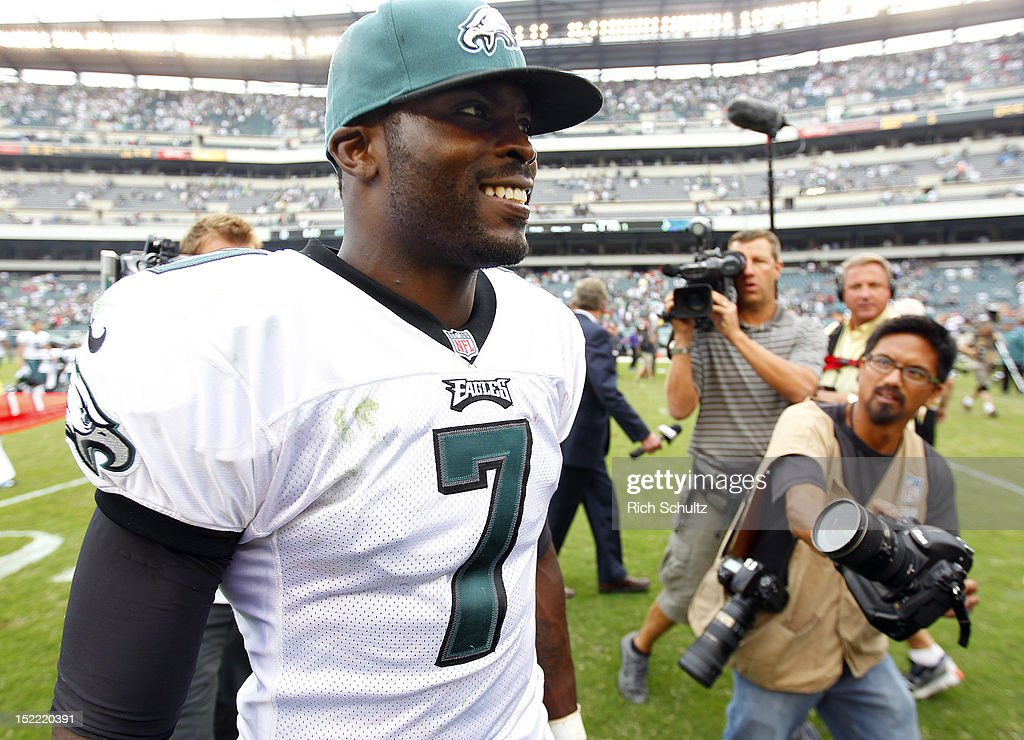 Quarterback <a gi-track='captionPersonalityLinkClicked' href=/galleries/search?phrase=Michael+Vick&family=editorial&specificpeople=201746 ng-click='$event.stopPropagation()'>Michael Vick</a> #7 of the Philadelphia Eagles walks off the field after defeating the Baltimore Ravens 24-23 during a game at Lincoln Financial Field on September 16, 2012 in Philadelphia, Pennsylvania.