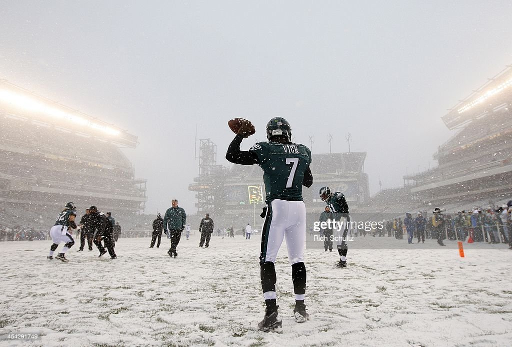 Quarterback Michael Vick #7 of the Philadelphia Eagles warms up in the snow before the start of a game against the Detroit Lions at Lincoln Financial Field on December 8, 2013 in Philadelphia, Pennsylvania.