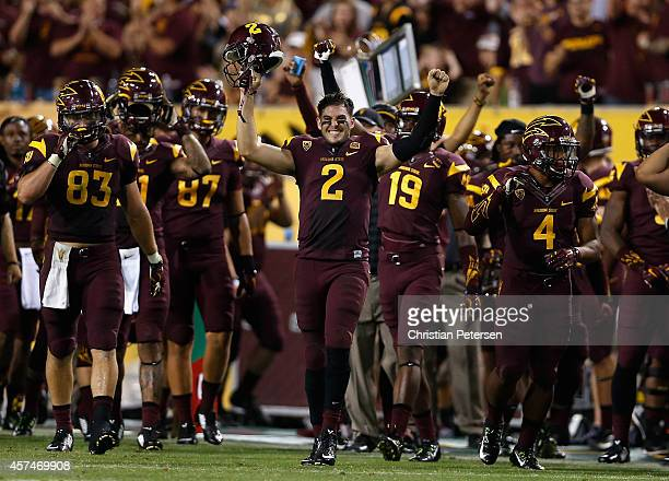 Quarterback Mike Bercovici of the Arizona State Sun Devils celebrates on the sidelines after the Sun Devils defense recovered a fumble against the...
