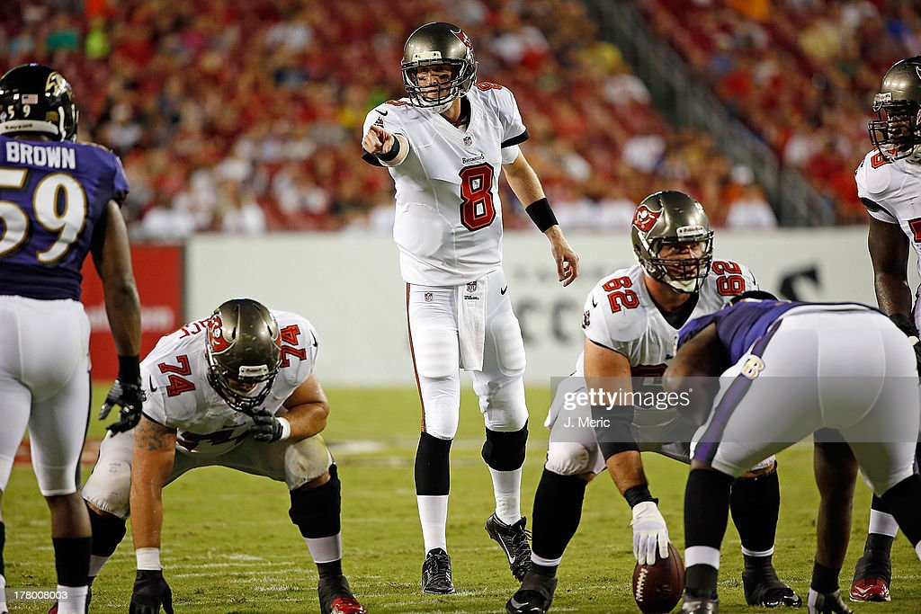 Quarterback Mike Glennon #8 of the Tampa Bay Buccaneers directs the offense against the Baltimore Ravens during a preseason game at Raymond James Stadium on August 8, 2013 in Tampa, Florida.
