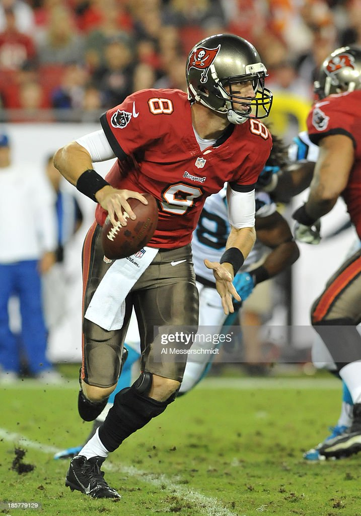 Quarterback Mike Glennon #8 of the Tampa Bay Buccaneers looks to pass against the Carolina Panthers October 24, 2013 at Raymond James Stadium in Tampa, Florida. Carolina won 31 - 13.