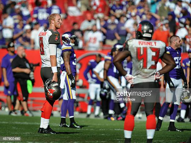 Quarterback Mike Glennon of the Tampa Bay Buccaneers stands on the field after the Minnesota Vikings scored a TD in overtime to win the game at...