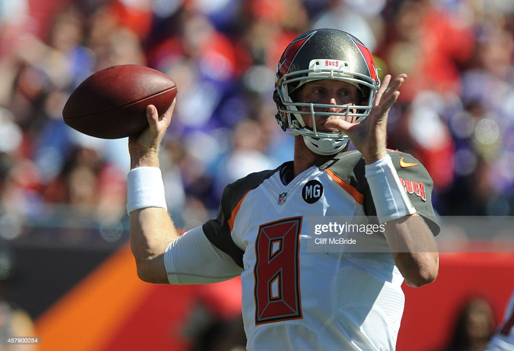 Quarterback <a gi-track='captionPersonalityLinkClicked' href=/galleries/search?phrase=Mike+Glennon+-+Footballspieler&family=editorial&specificpeople=11404080 ng-click='$event.stopPropagation()'>Mike Glennon</a> #8 of the Tampa Bay Buccaneers throws the ball against the Minnesota Vikings in the second quarter at Raymond James Stadium on October 26, 2014 in Tampa, Florida.