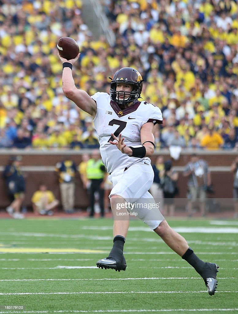 Quarterback Mitch Leinder #7 of the Minnesota Golden Gophers roles out to pass during the third quarter of the game against the Michigan Wolverines at Michigan Stadium on October 5, 2013 in Ann Arbor, Michigan. Michigan defeated Minnesota 42-13.