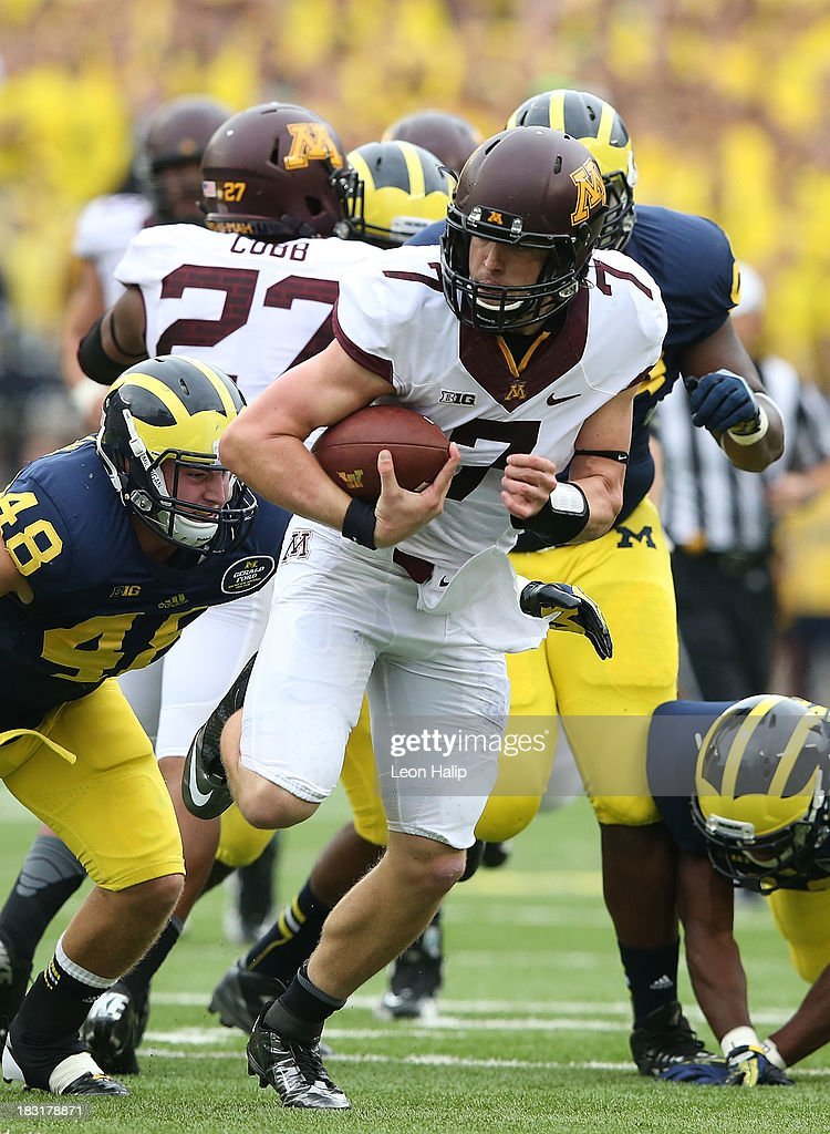 Quarterback Mitch Leinder #7 of the Minnesota Golden Gophers runs for a first down during the third quarter of the game against the Michigan Wolverines at Michigan Stadium on October 5, 2013 in Ann Arbor, Michigan. Michigan defeated Minnesota 42-13.
