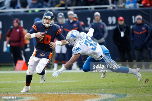 Quarterback Mitch Trubisky of the Chicago Bears runs with the football against Miles Killebrew of the Detroit Lions in the fourth quarter at Soldier...