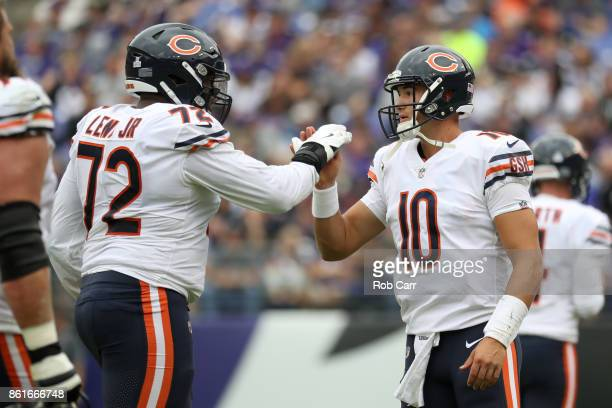 Quarterback Mitchell Trubisky and offensive tackle Charles Leno of the Chicago Bears celebrate during second quarter against the Baltimore Ravens at...