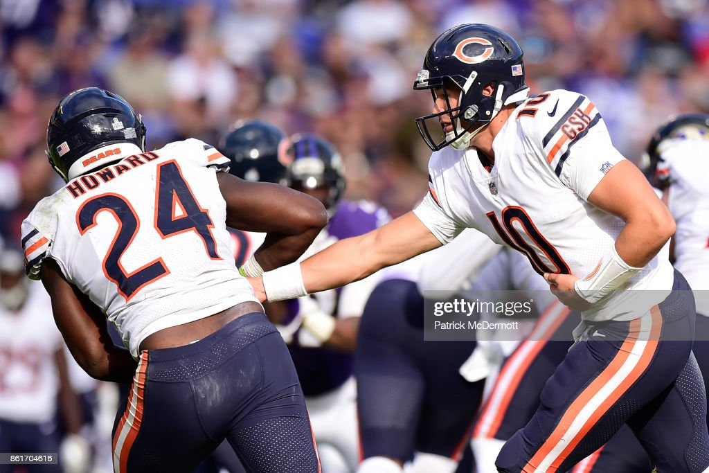 Quarterback Mitchell Trubisky #10 hands the ball off to running back Jordan Howard #24 of the Chicago Bears in the fourth quarter against the Baltimore Ravens at M&T Bank Stadium on October 15, 2017 in Baltimore, Maryland.