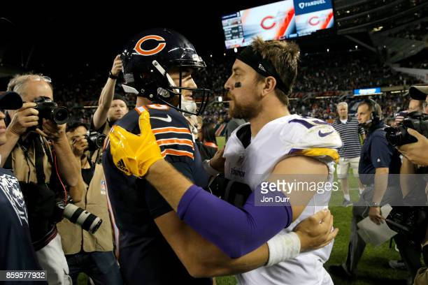 Quarterback Mitchell Trubisky of the Chicago Bears and Adam Thielen of the Minnesota Vikings hug after the Vikings defeated the Bears 2017 at Soldier...