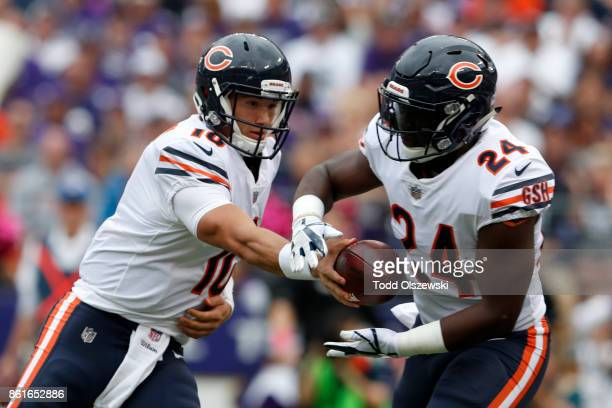 Quarterback Mitchell Trubisky of the Chicago Bears hands off to running back Jordan Howard in the first quarter against the Baltimore Ravens at MT...