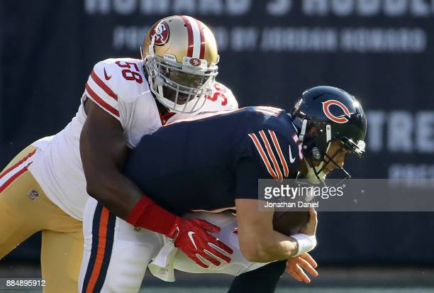 Quarterback Mitchell Trubisky of the Chicago Bears is sacked by Elvis Dumervil of the San Francisco 49ers in the first quarter at Soldier Field on...