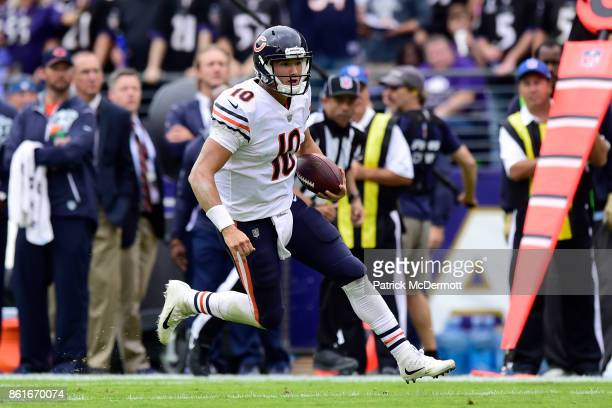 Quarterback Mitchell Trubisky of the Chicago Bears runs in the second quarter against the Baltimore Ravens at MT Bank Stadium on October 15 2017 in...
