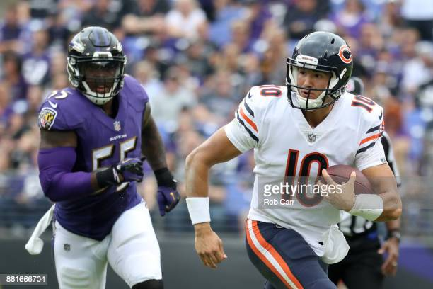 Quarterback Mitchell Trubisky of the Chicago Bears runs the ball in the second quarter against the Baltimore Ravens at MT Bank Stadium on October 15...