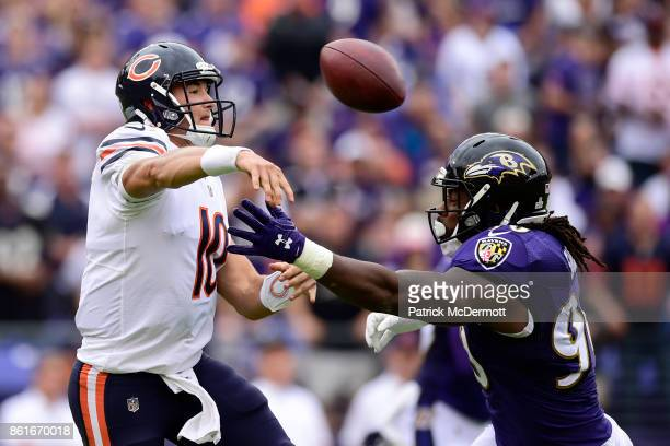 Quarterback Mitchell Trubisky of the Chicago Bears throws in the second quarter against the Baltimore Ravens at MT Bank Stadium on October 15 2017 in...