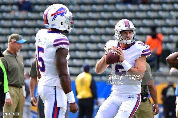 Quarterback Nathan Peterman of the Buffalo Bills warms up alongside Tyrod Taylor of the Buffalo Bills before the game against the Los Angeles...