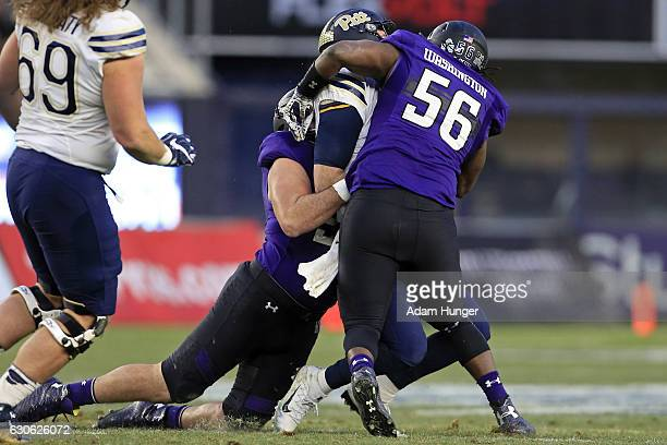 Quarterback Nathan Peterman of the Pittsburgh Panthers gets sacked between defensive end Xavier Washington of the Northwestern Wildcats and defensive...