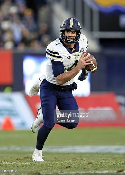 Quarterback Nathan Peterman of the Pittsburgh Panthers in action during the New Era Pinstripe Bowl against the Northwestern Wildcats at Yankee...