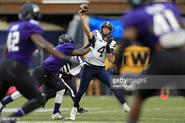 Quarterback Nathan Peterman of the Pittsburgh Panthers passes under pressure by defensive lineman Ifeadi Odenigbo of the Northwestern Wildcats during...