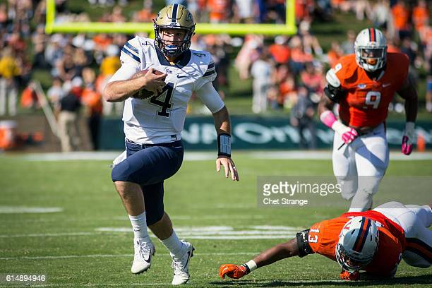 Quarterback Nathan Peterman of the Pittsburgh Panthers runs the ball during the Panthers' game against the Virginia Cavaliers at Scott Stadium on...