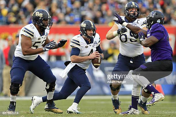 Quarterback Nathan Peterman of the Pittsburgh Panthers rushes against the Northwestern Wildcats during the New Era Pinstripe Bowl at Yankee Stadium...