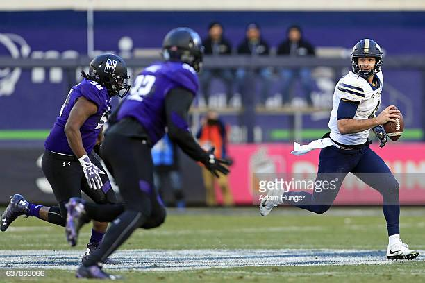 Quarterback Nathan Peterman of the Pittsburgh Panthers rushes under pressure from linebacker Nate Hall of the Northwestern Wildcats during the New...