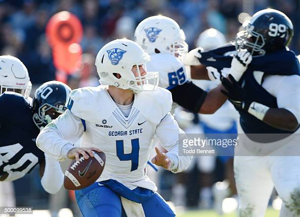 Quarterback Nick Arbuckle of the Georgia State Panthers looks downfield as he's pressured by defenders from the Georgia Southern Eagles during the...