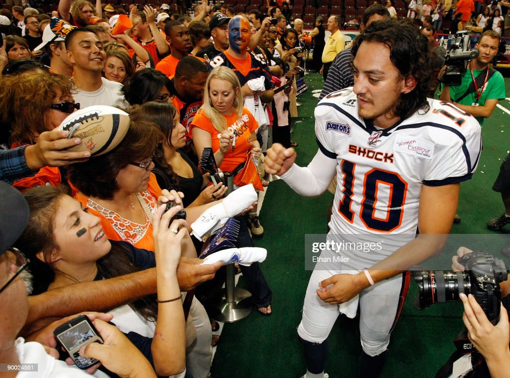Quarterback Nick Davila #10 of the Spokane Shock greets fans after the team's 74-27 victory over the Wilkes-Barre/Scranton Pioneers in the AFL2 ArenaCup 10 at the Orleans Arena August 22, 2009 in Las Vegas, Nevada.