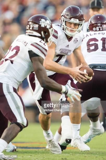 Quarterback Nick Fitzgerald of the Mississippi State Bulldogs looks to hand the ball off to running back Aeris Williams of the Mississippi State...