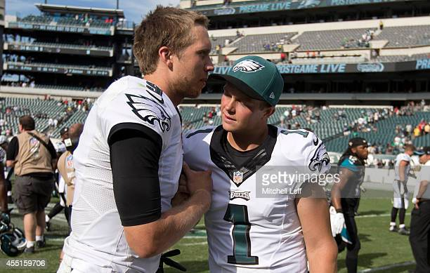 Quarterback Nick Foles of the Philadelphia Eagles and kicker Cody Parkey embrace after the Eagles defeated the Jacksonville Jaguars 3417 on September...