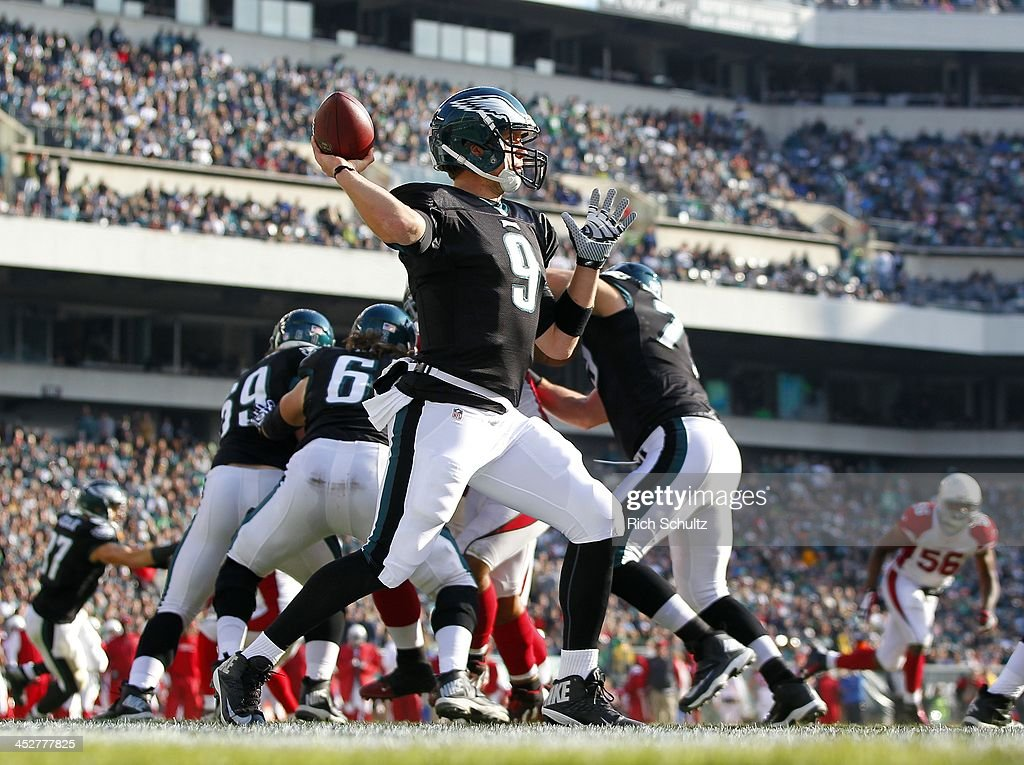 Quarterback <a gi-track='captionPersonalityLinkClicked' href=/galleries/search?phrase=Nick+Foles&family=editorial&specificpeople=4620741 ng-click='$event.stopPropagation()'>Nick Foles</a> #9 of the Philadelphia Eagles looks to pass out of the end zone in the second quarter against the Arizona Cardinals during a game at Lincoln Financial Field on December 1, 2013 in Philadelphia, Pennsylvania.