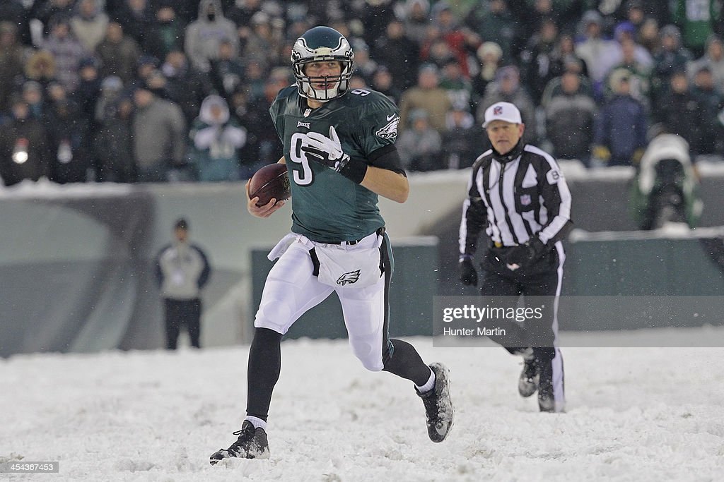 Quarterback <a gi-track='captionPersonalityLinkClicked' href=/galleries/search?phrase=Nick+Foles&family=editorial&specificpeople=4620741 ng-click='$event.stopPropagation()'>Nick Foles</a> #9 of the Philadelphia Eagles runs with the ball during a game against the Detroit Lions on December 8, 2013 at Lincoln Financial Field in Philadelphia, Pennsylvania. The Eagles won 34-20.