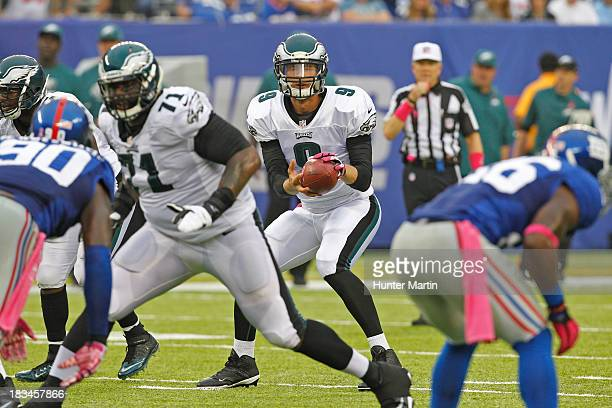 Quarterback Nick Foles of the Philadelphia Eagles takes a snap from center during a game against the New York Giants on October 6 2013 at MetLife...