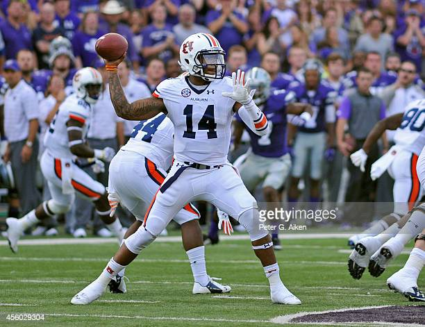 Quarterback Nick Marshall of the Auburn Tigers drops back to pass against the Kansas State Wildcats during the first half on September 18 2014 at...